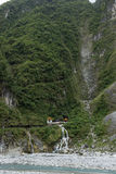 Waterfall and Eternal Spring Shrine at steep mountain at Taroko, Taiwan Royalty Free Stock Photo