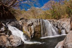 Waterfall in exotic Costa Rica near Samara beach on east coast. Falls with swimmning hole, lots of fun, the best vacation, tropical country royalty free stock photography