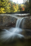 Waterfall and fall foliage at Diana's Baths, New Hampshire. Royalty Free Stock Photo
