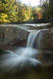 Waterfall and fall foliage at Diana's Baths, New Hampshire. Royalty Free Stock Photo