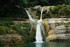 Waterfall in fall stock image