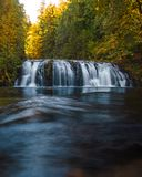 Waterfall during fall time in Oregon. A beautiful scene on an Oregon stream Royalty Free Stock Photos