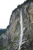 Waterfall falling from cliff in Lauterbrunnen Stock Photography