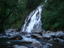 Waterfall is falling down from the hills. Majestic view of waterfall is falling down from the hills stock photo