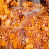Waterfall falling on the orange and gold rocks. Iceland stock photography