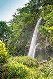Waterfall is falling from a rock Royalty Free Stock Photos