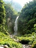 Waterfall falling to Marsyangdi river, Nepal - Annapurna trekking Royalty Free Stock Photos