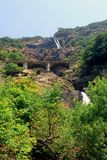 Waterfall. Falls and the railway bridge in the Indian mountains royalty free stock images