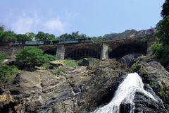 Waterfall. Falls and the railway bridge in the Indian mountains stock images