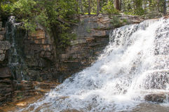 Waterfall with fast flowing water. Stock Images