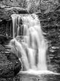Waterfall. Feathery looking waterfall in black and grey Royalty Free Stock Photo