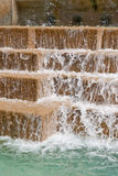 Waterfall feature. A waterfall feature on a pool or a pond royalty free stock image