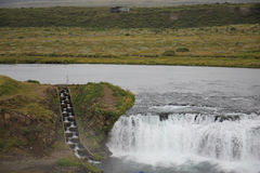 Waterfall and fish ladder in Iceland Stock Images