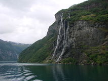Waterfall and fjord Stock Photography