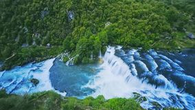 Waterfall flow aerial shot stock video footage