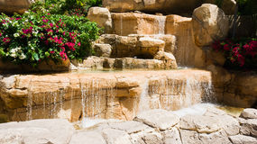 Waterfall and flowers Stock Photo