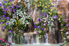 Waterfall and flowers in garden Royalty Free Stock Photos
