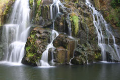 Waterfall Flowing. Over rocks covered in mosses and lichens Royalty Free Stock Image
