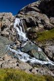 Waterfall flowing from Ala-Kul lake. Kyrgyzstan Royalty Free Stock Images