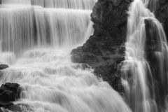 Waterfall flowing. In black and white Royalty Free Stock Images
