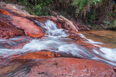 Waterfall Flowing Down Over Rocks. Waterfall located in the interior of Brazil Flowing Down Rocks Stock Photos