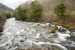Waterfall flowing down on slope. Ryuzu waterfall flowing down on rock slope in Nikko Stock Photography