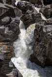 Waterfall Flowing Between the Lava Stones Royalty Free Stock Photography