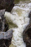 Waterfall Flowing Between the Lava Stones Stock Photography