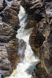 Waterfall Flowing Between the Lava Stones Stock Photo