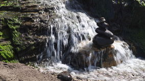 Waterfall Flowing Over Rocks in California. The Alomere waterfall flows from a cliff to the beach at Point Reyes National Seashore in northern California. This stock footage
