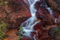Waterfall Flowing Over Rocks. Waterfall located in the interior of Brazil Flowing Down Rocks Royalty Free Stock Photos