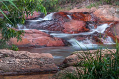 Waterfall Flowing Over Rocks. Waterfall located in the interior of Brazil Flowing Down Rocks Royalty Free Stock Photography
