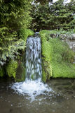 Waterfall Flowing into River Stock Images