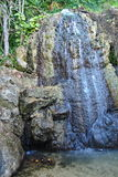 Waterfall. A flowing waterfall surrounded by trees in Jamaica the caribbean royalty free stock photo