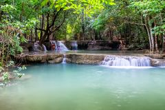 Waterfall flowing on tropical rainforest at huai mae khamin nati Stock Image