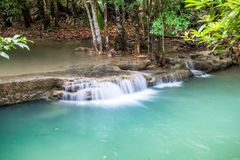 Waterfall flowing on tropical rainforest at huai mae khamin nati Royalty Free Stock Image
