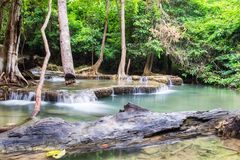 Waterfall flowing in tropical rainforest at huai mae khamin nati Stock Photography