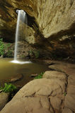 Waterfall flows into holes. Stock Photography