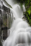 Waterfall flows softly over the rocks. In spring Stock Image
