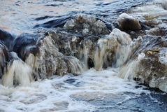 Waterfall, foaming and splashing waves of a river Royalty Free Stock Images