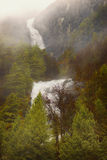 Fjord Waterfall in Fog, Norway Stock Images