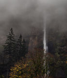 Waterfall in the Foggy Mist Royalty Free Stock Photography