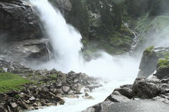 Waterfall. Foggy waterfall in mountains by Mittersill (Alps, Austria) at summer time Stock Image