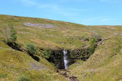 Waterfall on Force Gill east of Whernside. Looking at a waterfall on Force Gill on the eastern side on Whernside (one of the three peaks mountains) in North Royalty Free Stock Photos