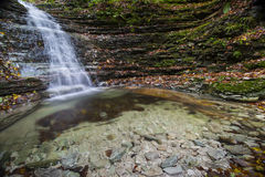Waterfall in the forest in autumn, Monte Cucco NP, Umbria, Italy Royalty Free Stock Image