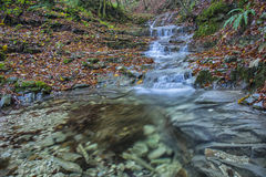 Waterfall in the forest in autumn, Monte Cucco NP, Umbria, Italy Stock Image