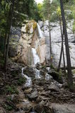Waterfall in the forest. Beautiful waterfall in autumnal twilight forest Royalty Free Stock Photos