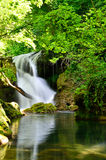 Waterfall into the forest Stock Photography