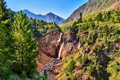Waterfall in forest border in mountains Stock Photography