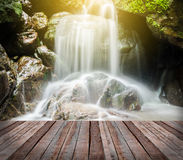 Waterfall in the forest and bridge. Royalty Free Stock Photography